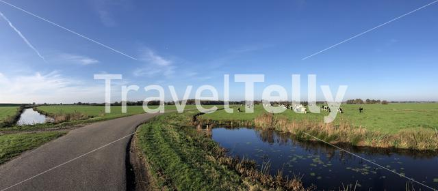 Panorama from a road through farmland during autumn around Sondel in Friesland, The Netherlands