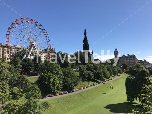 Ferris wheel and the Scott Monument in Edinburgh Scotland
