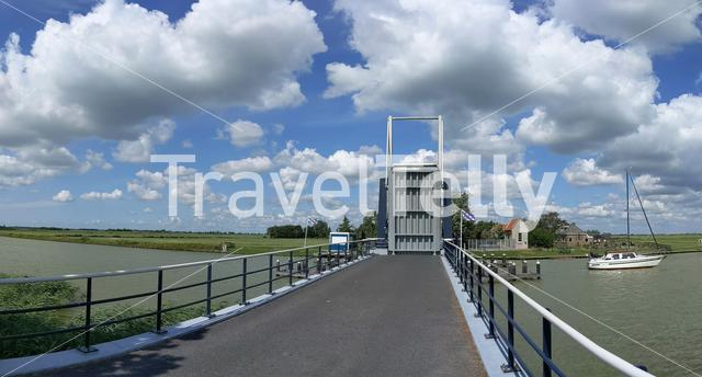Bridge open for a sailboat in Friesland The Netherlands