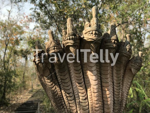 Statue next to the stairs towards a buddhism temple in Phanom Sawai Forest Park Thailand