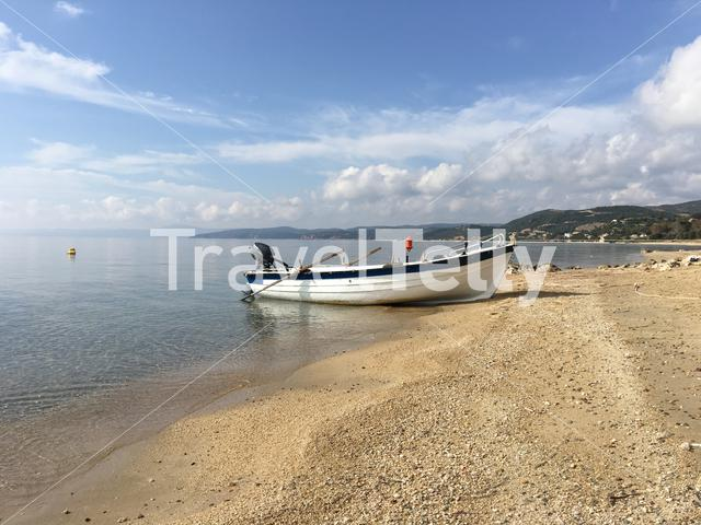 A small boat at the beach in Greece