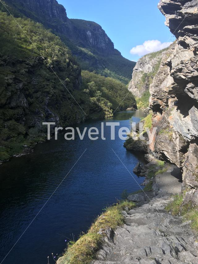 Hiking along the Aurlandselva river through the beautiful Aurlandsdalen valley in Norway.