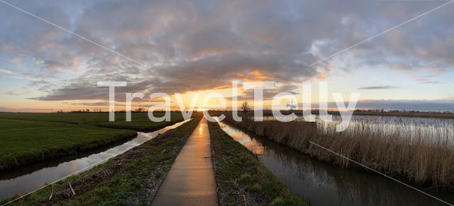 Sunset on a path towards IJlst in Friesland The Netherlands