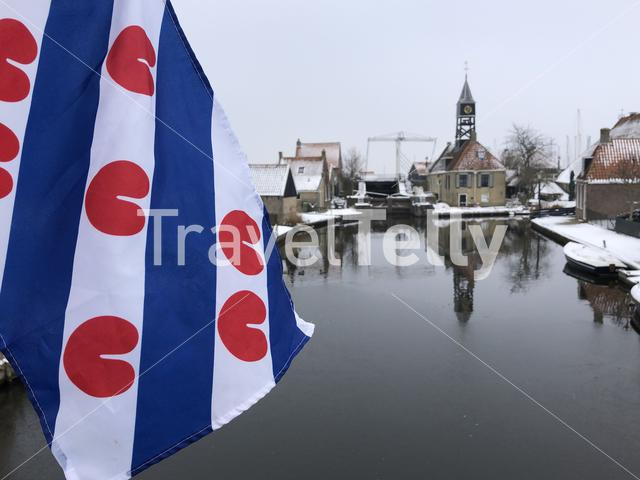 Frisian flag in Hindeloopen during winter in Friesland The Netherlands