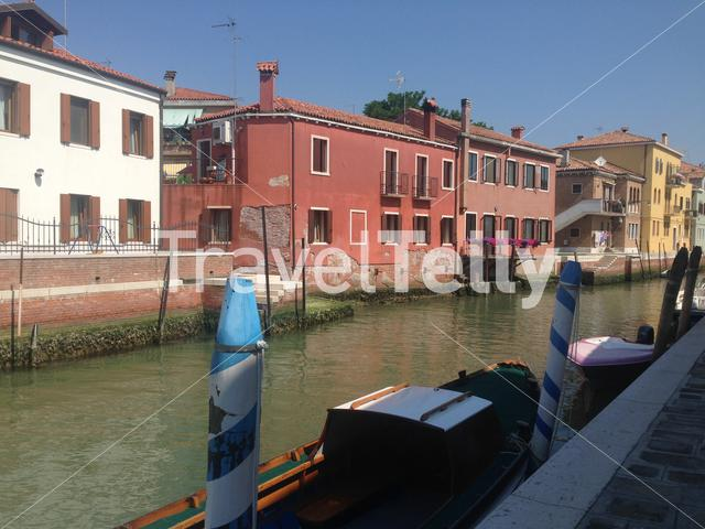 Canal with colorful houses in Murano Venezia, Italy