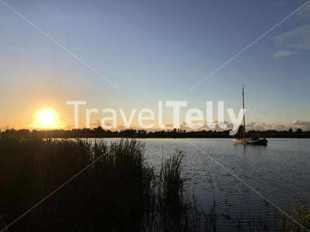 Sailboat during sunset on a frisian lake