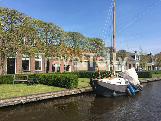 Houses and a sailboat in Ijlst Friesland The Netherlands