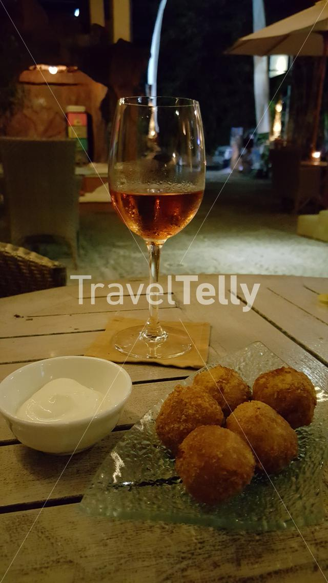 Typical Dutch bitterballs with glass of wine in Ubud, Indonesia