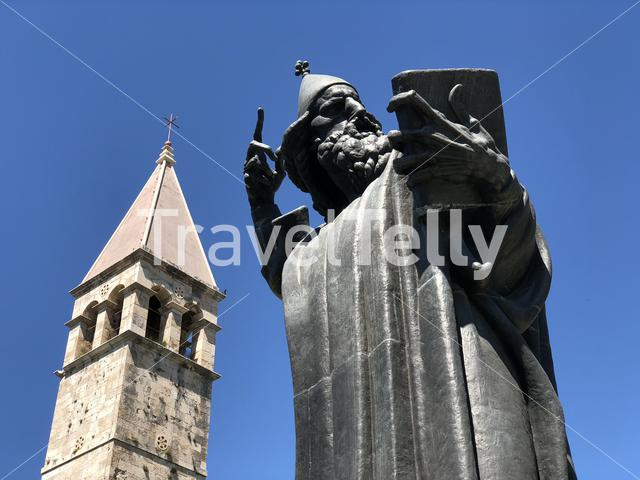 Close up from the giant statue of Gregory of Nin and the Chapel of Arnir in Split Croatia