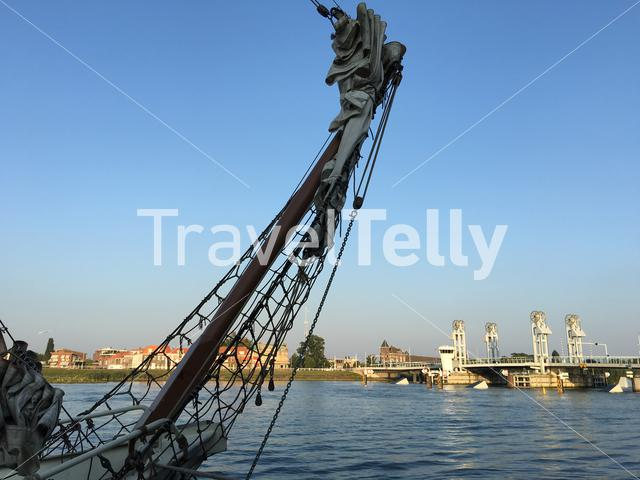 Sailboat in Kampen with the citybridge in the background in The Netherlands
