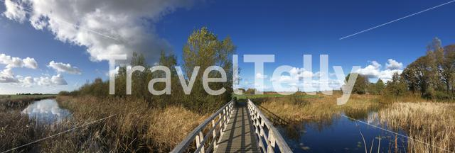 Panoramic from a bicycle path bridge over a canal in a nature reserve around Wolvega in Friesland, The Netherlands