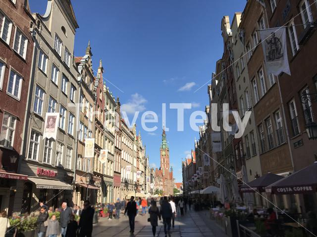 Street with in the background the town hall in Gdansk Poland