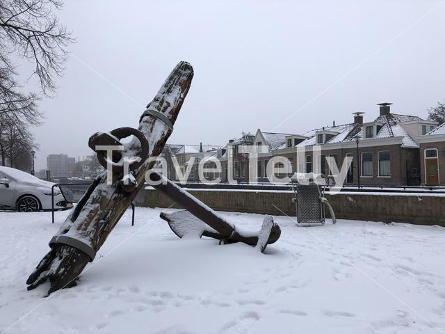 Big anchor with snow next to the canal around Sneek, Friesland The Netherlands