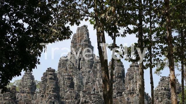 Angkor Thom temple with smiling faces carved into stone walls at Krong Siem Reap, Cambodia