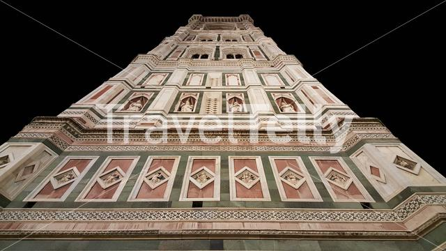 Giotto's Campanile is a free-standing campanile from Florence Cathedral on the Piazza del Duomo in Florence, Italy at night.