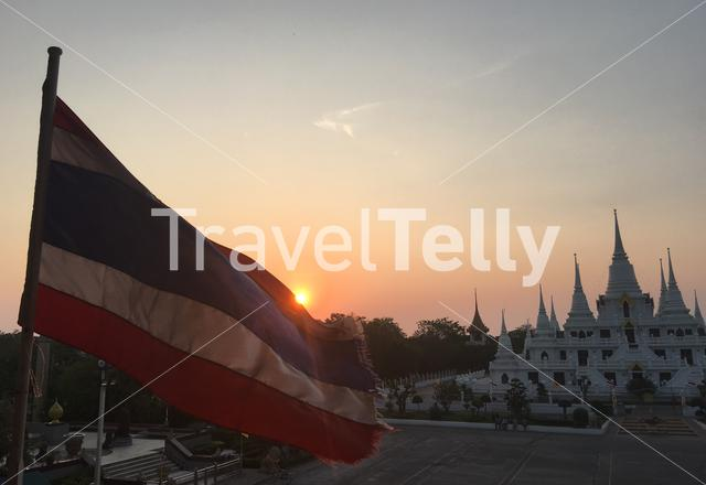 Sunset and Thai flag at Wat Asokaram, Samut Prakan Bangkok Thailand