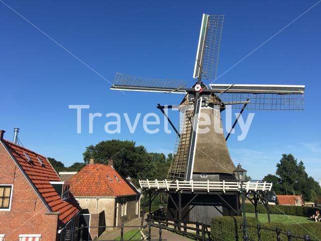 Houses and a old windmill in Sloten Friesland The Netherlands