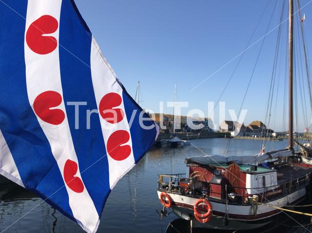 Frisian flag in the harbor of Stavoren, Friesland The Netherlands