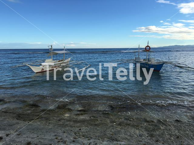 Catamaran Boat in the water at Balicasag Island in Bohol the Philippines