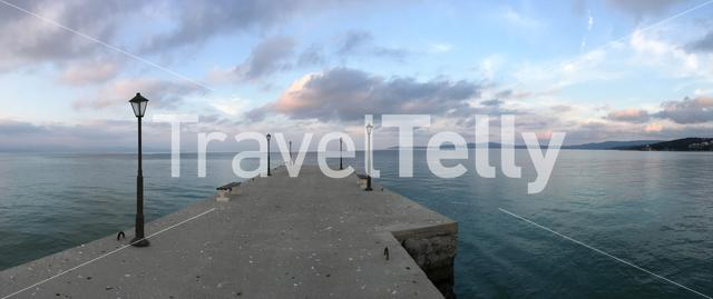 Panorama with a pier with lanterns in Nea Roda Greece