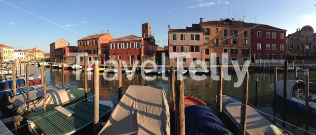 Panorama from a canal with boats in Murano Venezia, Italy