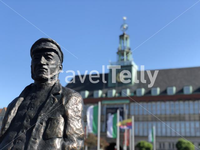 Statue of the Emder Delftspucker in Emden Germany