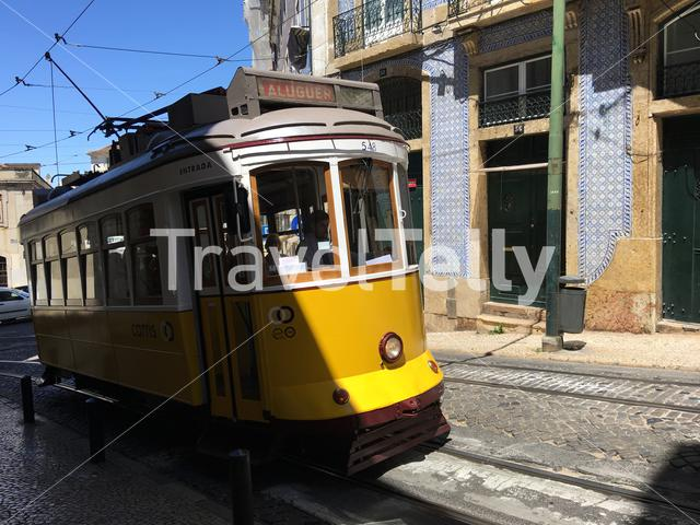 A yellow tram in the streets of Lisbon Portugal