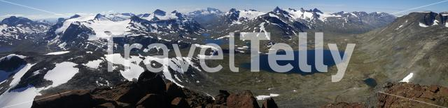 Panorama from lakes and snowy mountains in Jotunheimen National Park Norway