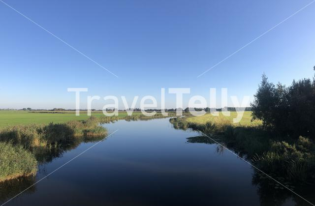 Quiet canal around tersoal in Friesland The Netherlands