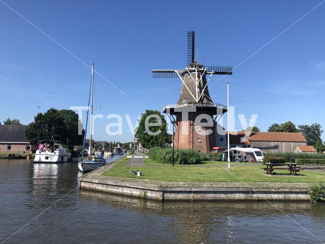 Windmill next to a canal in Burdaard, Friesland, The Netherlands