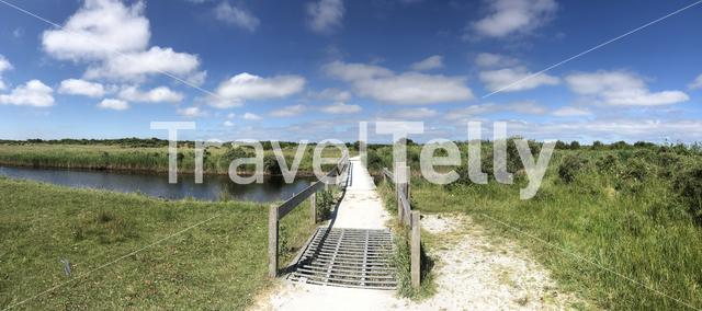 Bicycle bridge over a river on Schiermonnikoog in Friesland, The Netherlands