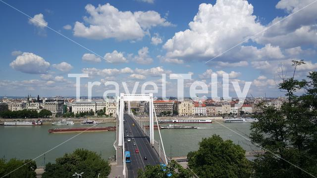 Cargo ship passing by the Elisabeth Bridge who spanning the River Danube joining the cities of Buda & Pest in Budapest Hungary