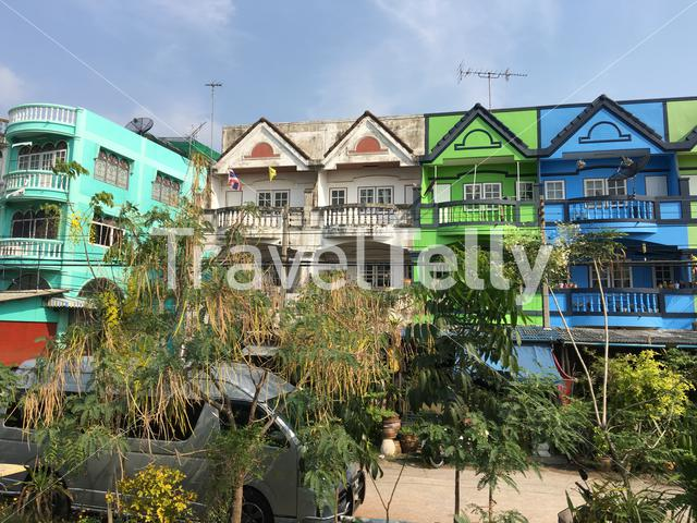 Colorful houses next to the railway from Bangkok to Samut Sakhon