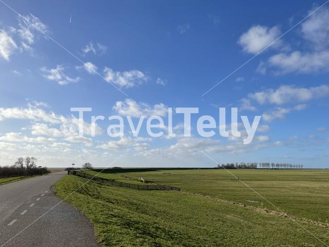 Road on a dyke around Laaksum in Friesland, The Netherlands