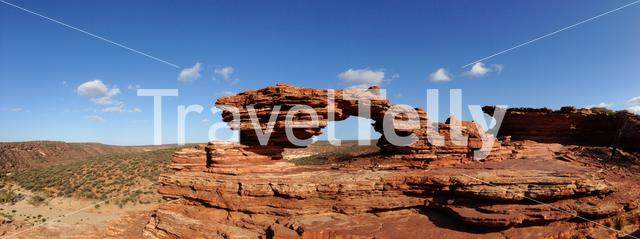 Panorama Natures Window is a natural arch carved from red rock in Kalbarri National Park