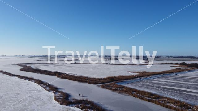 People ice skating on a frozen lake around Sneek in Friesland The Netherlands