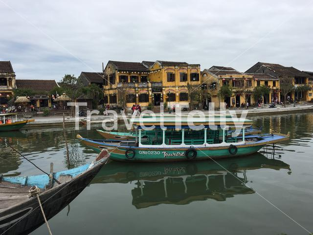Boats at the Thu Bon river in Hoi An Vietnam