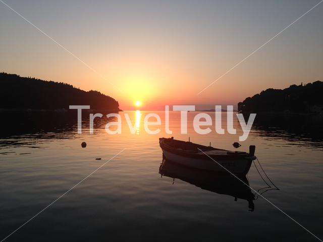 Sunset with a boat in Cavtat Croatia