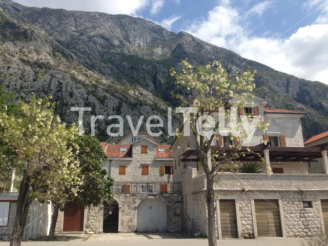House in front of a big mountain in Kotor Bay Montenegro
