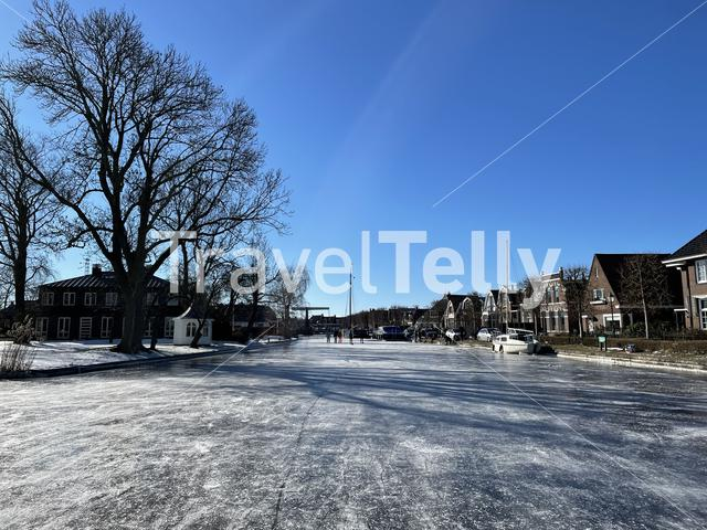 Frozen canal in IJlst, Friesland The Netherlands