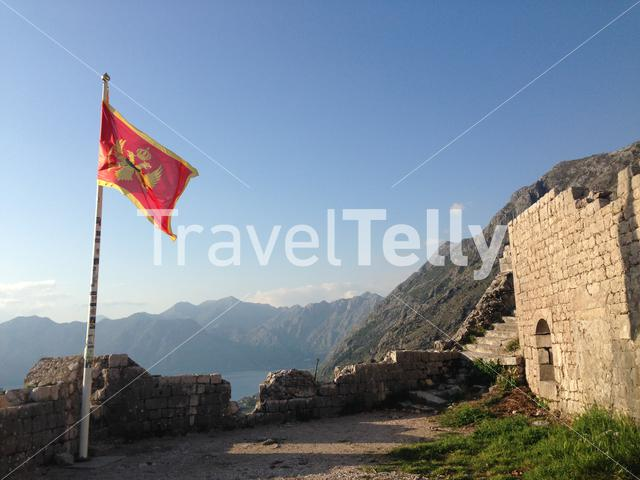 The flag of Montenegro and fortifications of Kotor in Montenegro