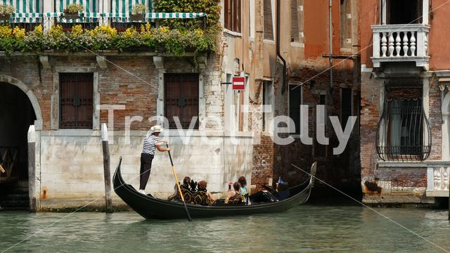 Gondola with tourists in Venice Italy