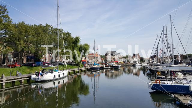 Lots of boats in old harbor in Enkhuizen