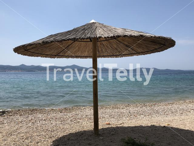 Beach parasol on a beach in Zadar, Croatia