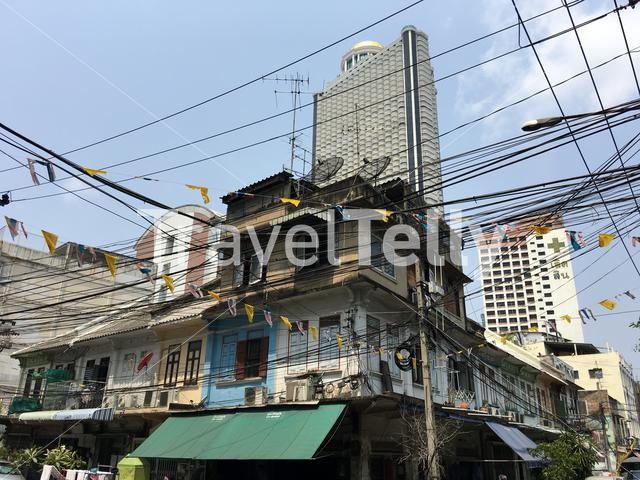 Old houses in front of the centre point Hotel in Silom Bangkok Thailand
