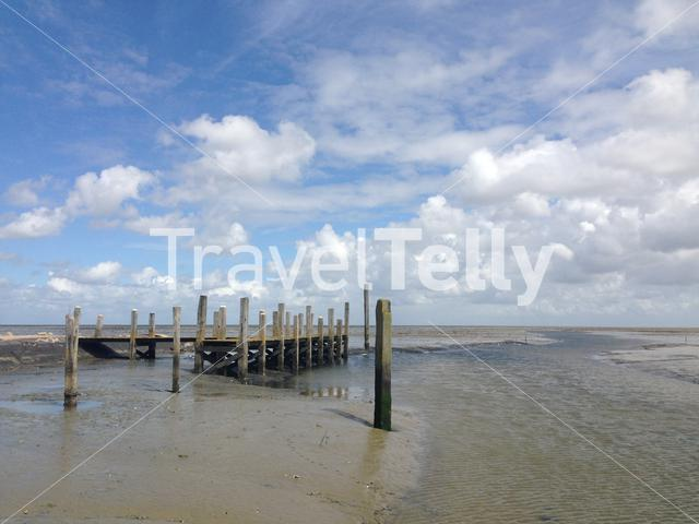 A pier during low tide in Texel The Netherlands