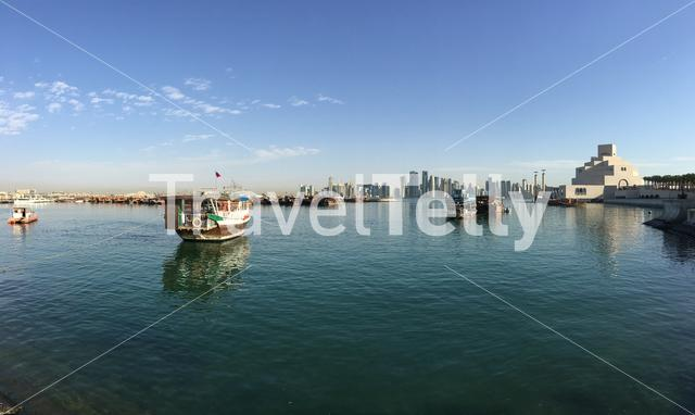 Panorama from the Museum of Islamic Art on the Corniche with a traditional Dhow, Arab sailing vessel in the Dhow Harbour in Doha Qatar