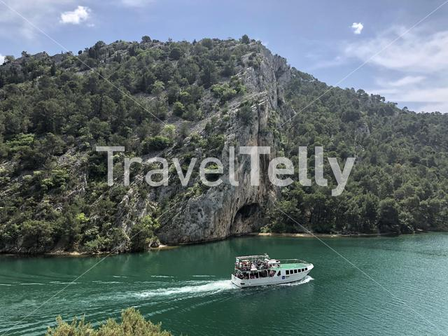 Ferry with tourists on the Krka River in Croatia