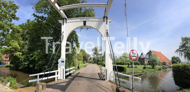 Bridge over a canal in Sibrandabuorren Friesland The Netherlands