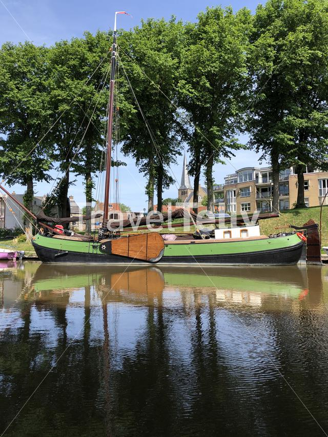 Sailboat in a canal around Harlingen, Friesland The Netherlands